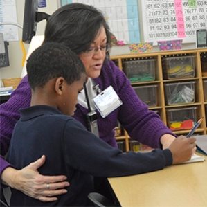 Vicki Boase helps comfort an unhappy student